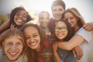 group of 7 teens smiling